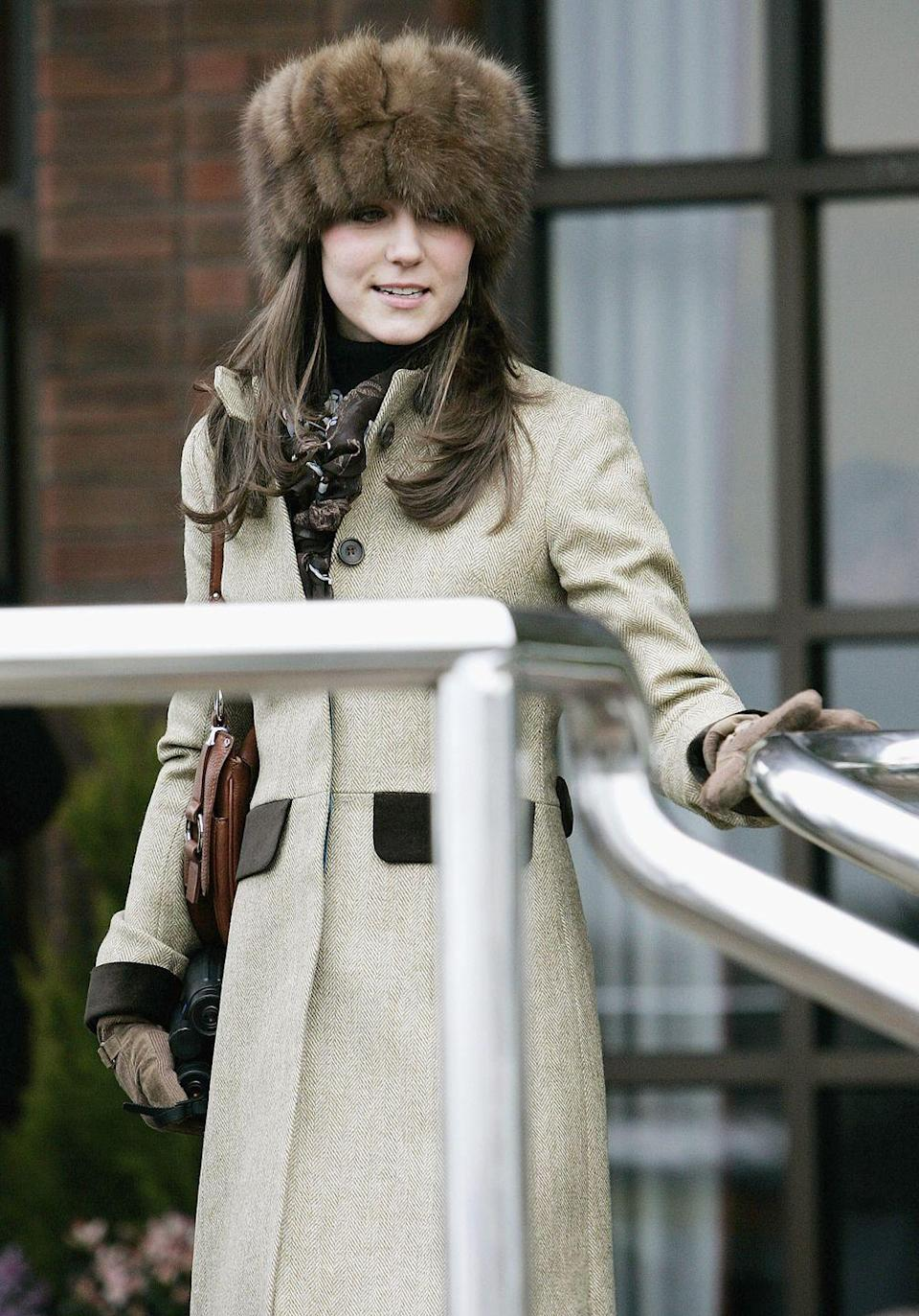 <p>Wearing a Russian-style fur hat to the final day of Cheltenham Races in England.<br></p>