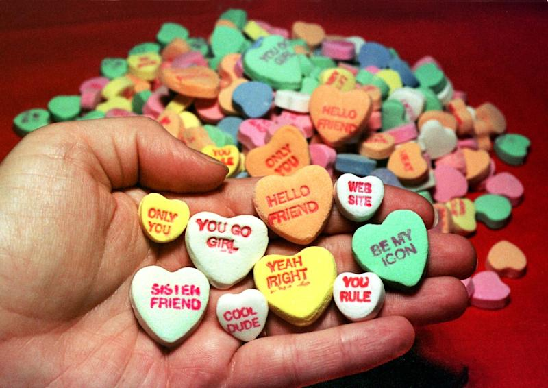 "Necco candy hearts from 1998 with phrases like ""YOU GO GIRL"" and ""WEB SITE."" (Jim Bourg / Reuters)"