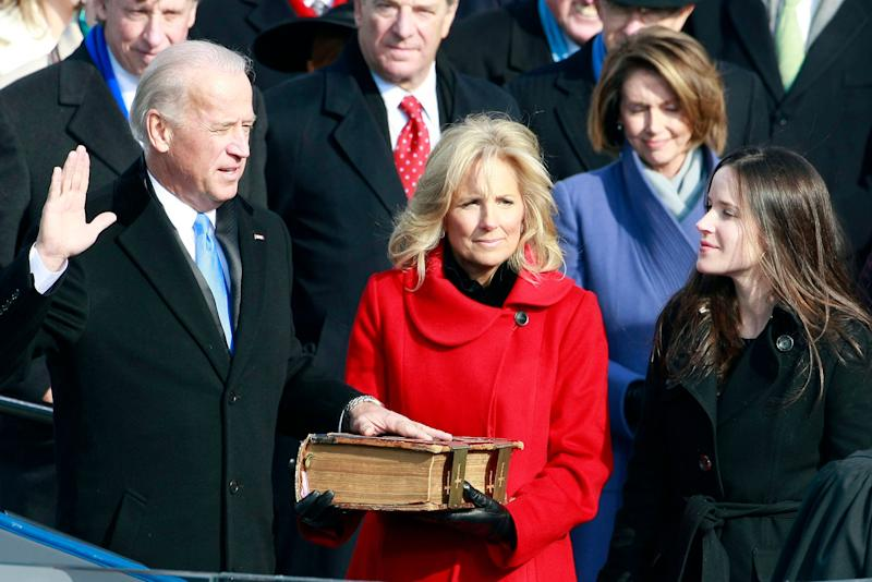 Biden is sworn in by Supreme Court Justice John Paul Stevens during the inauguration of Obama as the 44th president on Jan. 20, 2009.