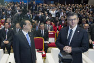 Croatia's Prime Minister Andrej Plenkovic, right, and his Chinese counterpart Li Keqiang attend the beginning of the Summit of Central and Eastern Europe and China in Dubrovnik, Croatia, Friday, April 12, 2019. EU member Croatia is hosting a two-day summit between China and 16 regional countries on expanding business between China and the region, which is dubbed 16+1. (AP Photo/Darko Bandic)