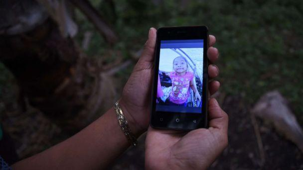 PHOTO: A relative shows a picture of 7-year old Jakelin Caal Maquin, who died in a Texas hospital two days after being taken into custody by border patrol agents, north of Guatemala city, Dec. 15, 2018. (Johan Ordonez/AFP/Getty Images)