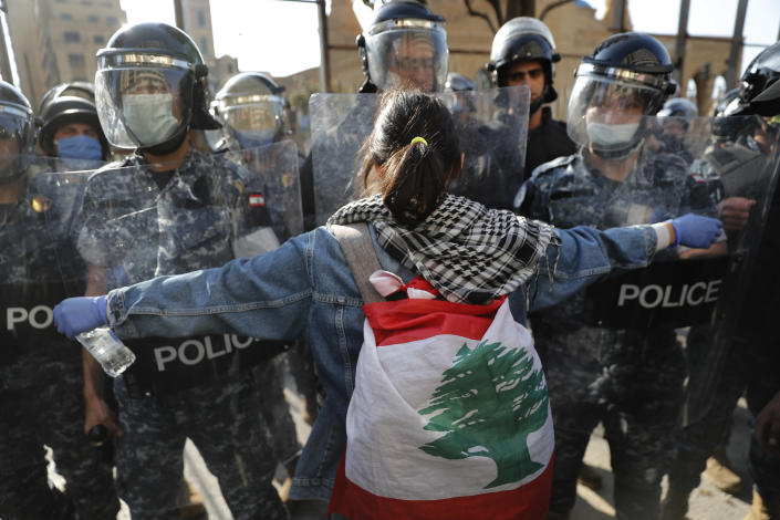 An anti-government protester confronts during a protest against the deepening financial crisis, in Beirut, Lebanon, Tuesday, April 28, 2020. Hundreds of protesters in Lebanon's northern city of Tripoli set fire Tuesday to two banks and hurled stones at soldiers, who responded with tear gas and batons in renewed clashes triggered by an economic crisis spiraling out of control amid a weeks-long virus lockdown. (AP Photo/Hussein Malla)