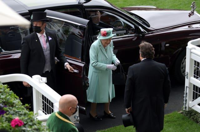 The Queen smiles as she arrives