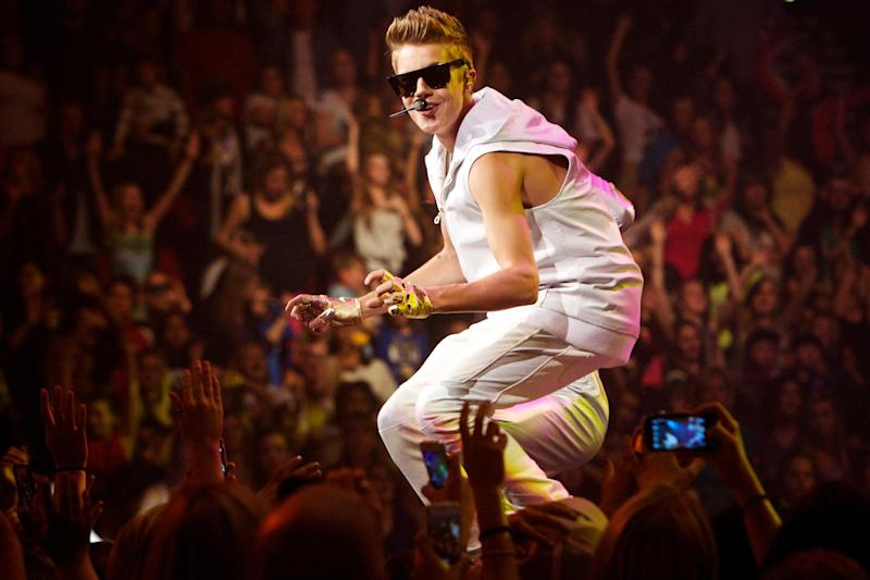 Justin Bieber performs at the Rose Garden in Portland, Ore., Monday, Oct. 8, 2012. (AP Photo/The Oregonian, Thomas Boyd)