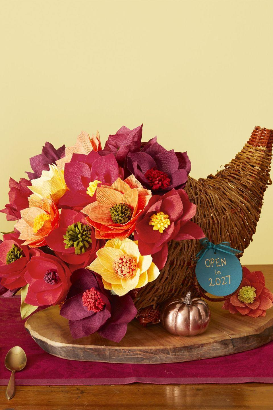 "<p>Whether you DIY or buy them premade, crepe flowers will last way longer than any grocery-store bouquet. Poke the stems into a floral foam-filled basket for a centerpiece-worthy cornucopia. </p><p><a class=""link rapid-noclick-resp"" href=""https://www.amazon.com/Handcrafted-Flowers-Backdrop-Birthday-Decoration/dp/B07S5K4FFS/ref=sr_1_46?dchild=1&keywords=crepe+flowers&qid=1595447121&sr=8-46&tag=syn-yahoo-20&ascsubtag=%5Bartid%7C10055.g.1681%5Bsrc%7Cyahoo-us"" rel=""nofollow noopener"" target=""_blank"" data-ylk=""slk:SHOP CREPE FLOWERS"">SHOP CREPE FLOWERS</a><br></p><p><em><a href=""https://www.womansday.com/home/decorating/g269/easy-fall-centerpiece-ideas-124043/?slide=11"" rel=""nofollow noopener"" target=""_blank"" data-ylk=""slk:Get the tutorial at Woman's Day »"" class=""link rapid-noclick-resp"">Get the tutorial at Woman's Day »</a></em></p>"