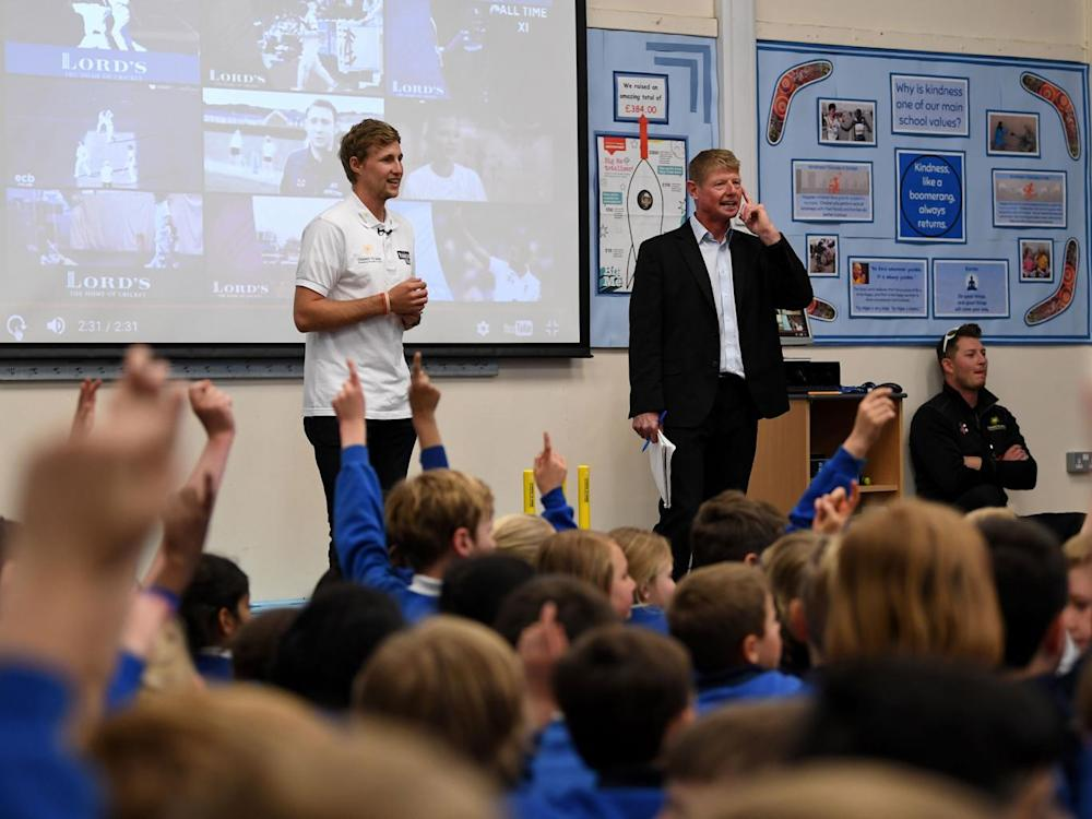 Root takes part in assembly as he visits his former school, Dore Primary School (Getty)