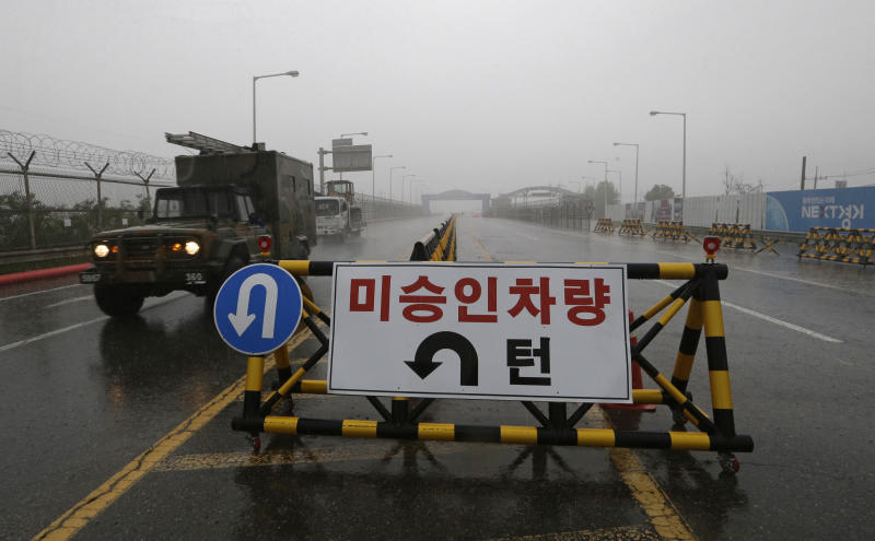 "A South Korean military vehicle crosses Unification Bridge, which leads to the demilitarized zone, near the border village of Panmunjom in Paju, South Korea, Wednesday, May 16, 2018. North Korea on Wednesday canceled a high-level meeting with South Korea and threatened to scrap a historic summit next month between U.S. President Donald Trump and North Korean leader Kim Jong Un over military exercises between Seoul and Washington that Pyongyang has long claimed are invasion rehearsals. The barricade reads: ""Vehicles disapproved."" (AP Photo/Ahn Young-joon)"