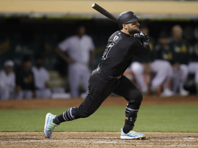San Francisco Giants' Kevin Pillar watches his two-run double off Oakland Athletics' Lou Trivino during the eighth inning of a baseball game Saturday, Aug. 24, 2019, in Oakland, Calif. (AP Photo/Ben Margot)