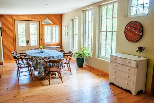 <p>Here's the dining room with beautiful wood floors and double doors that open up to the deck. (Airbnb) </p>
