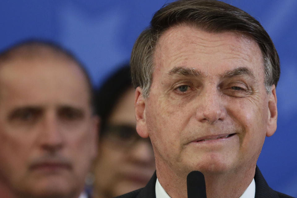 Brazil's President Jair Bolsonaro speaks during a press conference on the resignation of Justice Minister Sergio Moro, at the Planalto Presidential Palace in Brasilia, Brazil, Friday, April 24, 2020. Moro, who became popular as a crusader against corruption, resigned on Friday, alleging political interference in the federal police force. (AP Photo/Eraldo Peres)