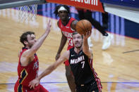 Miami Heat guard Goran Dragic (7) goes to the basket against New Orleans Pelicans forward Nicolo Melli during the first half of an NBA basketball game in New Orleans, Thursday, March 4, 2021. (AP Photo/Gerald Herbert)