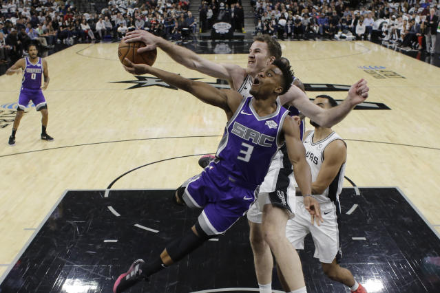 Sacramento Kings guard Yogi Ferrell (3) is blocked by San Antonio Spurs center Jakob Poeltl during the first half of an NBA basketball game in San Antonio, Friday, Dec. 6, 2019. (AP Photo/Eric Gay)