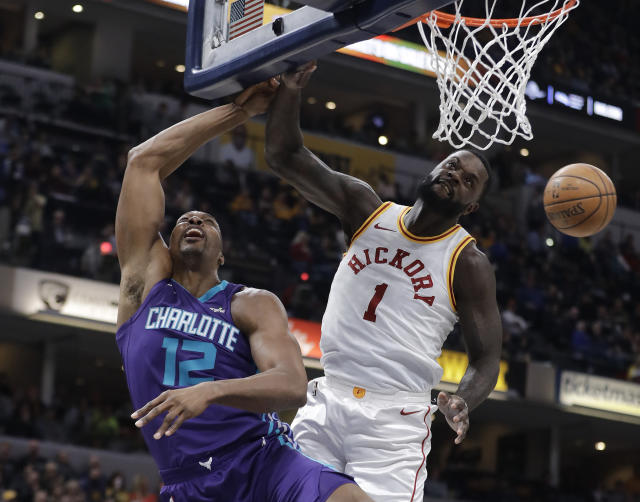 Pacers guard Lance Stephenson blocks Dwight Howard during Tuesday's game against the Hornets. (AP Photo)