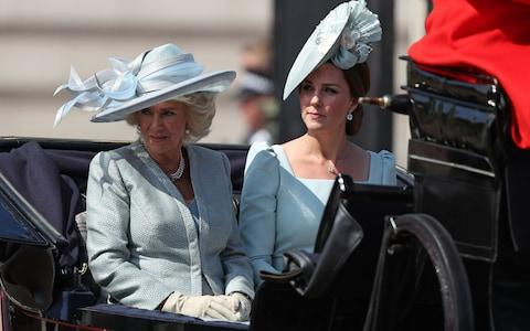 Britain's Camilla, Duchess of Cornwall (L) and Britain's Catherine, Duchess of Cambridge, travel in a carriage to Horseguards parade ahead of the Queen's Birthday Parade, 'Trooping the Colour', in London on June 9, 2018. The ceremony of Trooping the Colour is believed to have first been performed during the reign of King Charles II. In 1748, it was decided that the parade would be used to mark the official birthday of the Sovereign. More than 600 guardsmen and cavalry make up the parade, a celebration of the Sovereign's official birthday, although the Queen's actual birthday is on 21 April. - Credit: Daniel Leal-Olivas/AFP