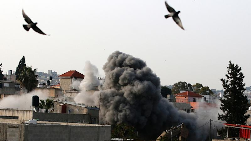 Israel's army used explosives and heavy machinery to destroy the home of a Palestinian accused of killing two Israelis