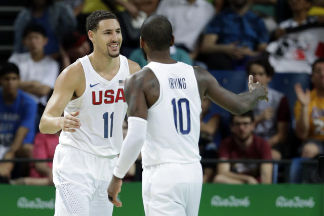 """Klay Thompson gets a high-five from <a class=""""link rapid-noclick-resp"""" href=""""/nba/players/4840/"""" data-ylk=""""slk:Kyrie Irving"""">Kyrie Irving</a>. (AP)"""