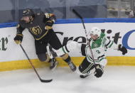 Dallas Stars' John Klingberg (3) is checked by Vegas Golden Knights' William Carrier (28) during the third period of an NHL hockey playoff game Monday, Aug. 3, 2020, in Edmonton, Alberta. (Jason Franson/The Canadian Press via AP)