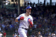 Chicago Cubs' Patrick Wisdom celebrates his home run off Cincinnati Reds starting pitcher Luis Castillo during the fourth inning of a baseball game Thursday, July 29, 2021, in Chicago. (AP Photo/Charles Rex Arbogast)