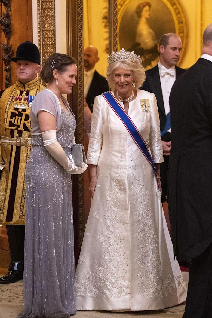 <p>Camilla dressed up at Buckingham Palace for an evening reception for members of the Diplomatic Corps. She chose an ivory gown and her famed Greville tiara. </p>