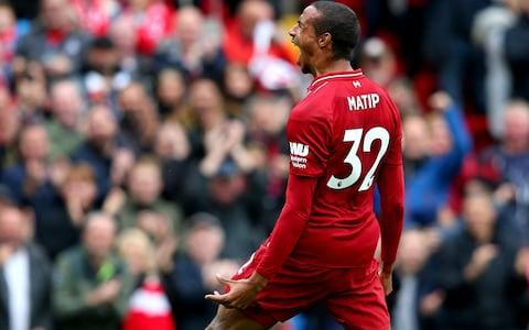 Joel Matip of Liverpool celebrates after scoring his team's second goal during the Premier League match between Liverpool FC and Southampton FC - Credit: Getty IAlex Liveseymages