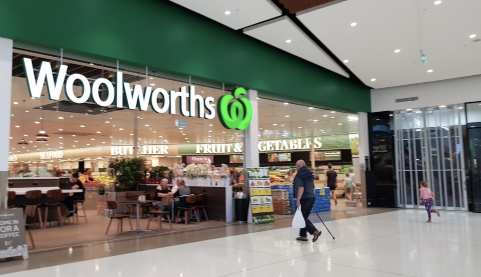 A customer walks into the Woolworths store at Glenrose Village.