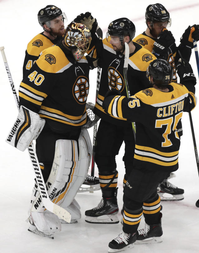 Boston Bruins goaltender Tuukka Rask (40), of Finland, is congratulated after the team's 5-2 win over the Carolina Hurricanes in Game 1 of the NHL hockey Stanley Cup Eastern Conference finals, Thursday, May 9, 2019, in Boston. (AP Photo/Charles Krupa)