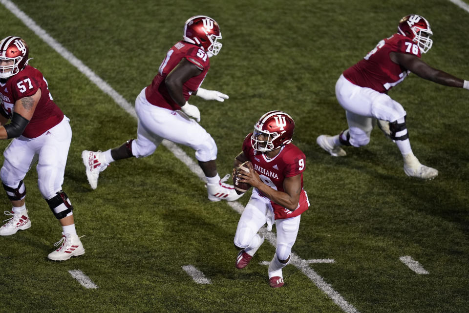 Indiana quarterback Michael Penix Jr. (9) runs in for a two-point conversion during overtime of an NCAA college football game against Penn State, Saturday, Oct. 24, 2020, in Bloomington, Ind. Indiana won 36-35 in overtime. (AP Photo/Darron Cummings)