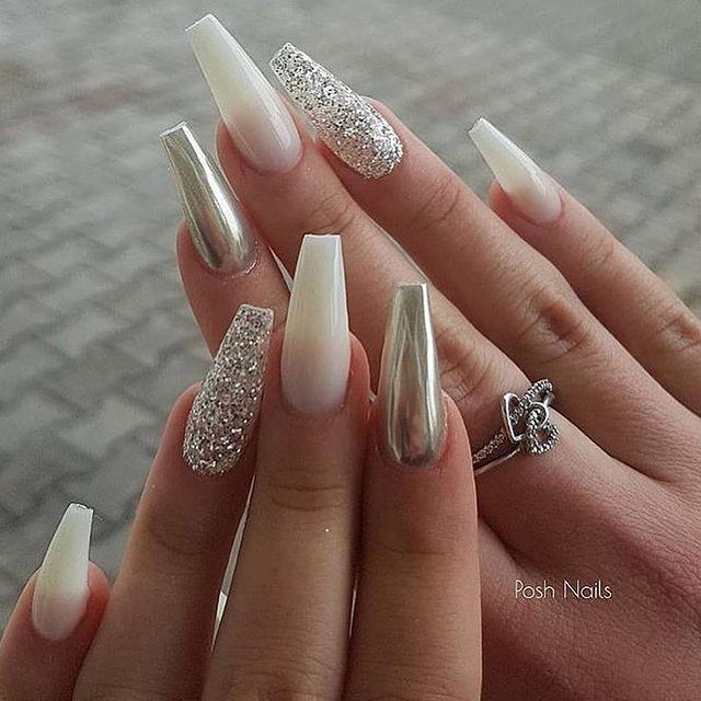 """<p>Nothing says New Year's like sparkling glitter and shiny chrome, and these nails have both.</p><p><a class=""""link rapid-noclick-resp"""" href=""""https://www.amazon.com/ZOYA-Polish-Cosmo-Magical-Pixiedust/dp/B00IVO9KKS/?tag=syn-yahoo-20&ascsubtag=%5Bartid%7C10055.g.29799716%5Bsrc%7Cyahoo-us"""" rel=""""nofollow noopener"""" target=""""_blank"""" data-ylk=""""slk:SHOP GLITTER NAIL POLISH"""">SHOP GLITTER NAIL POLISH</a></p><p><a href=""""https://www.instagram.com/p/B40G6GaiVe9/&hidecaption=true"""" rel=""""nofollow noopener"""" target=""""_blank"""" data-ylk=""""slk:See the original post on Instagram"""" class=""""link rapid-noclick-resp"""">See the original post on Instagram</a></p>"""