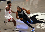 Brooklyn Nets forward Kevin Durant (7) drives to the basket around Chicago Bulls forward Patrick Williams during the second half of an NBA basketball game Saturday, May 15, 2021, in New York. (AP Photo/Adam Hunger)