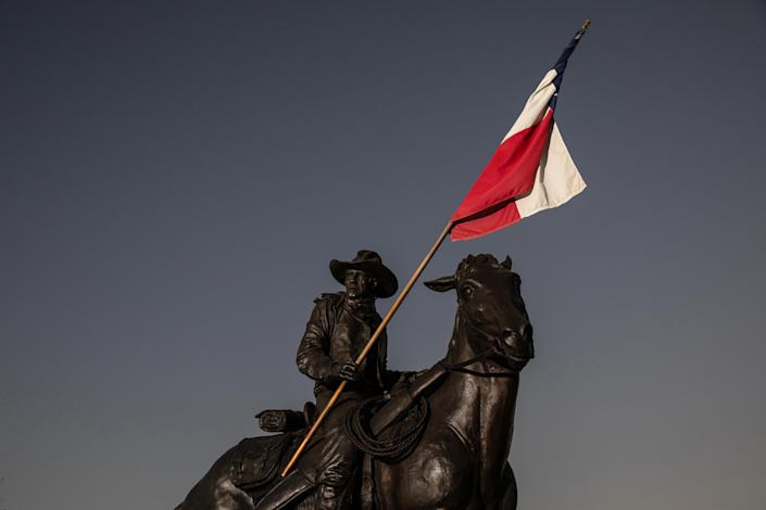 A sculpture of a Texas Ranger stands near the Texas Ranger Hall of Fame and Museum in Waco, Texas, Sept. 22, 2021. (Tamir Kalifa/The New York Times)