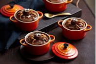 """<p>As well as Le Creuset's <a href=""""https://www.lecreuset.co.uk/en_GB/p/stoneware-petite-casserole/SW1901.html"""" rel=""""nofollow noopener"""" target=""""_blank"""" data-ylk=""""slk:Stoneware Petite Casseroles,"""" class=""""link rapid-noclick-resp"""">Stoneware Petite Casseroles, </a>to make these incredible puddings, you'll need:</p><p>•120g unsalted butter, plus extra for greasing <br>•120g golden caster sugar<br>•1 teaspoon vanilla extract<br>•100g self raising flour<br>•1 teaspoon baking powder<br>•50g cocoa powder <br>•2 eggs<br>•60g crunchy peanut butter<br>•1 tablespoon milk</p><p>To decorate</p><p>•300g chocolate spread<br>•6 Reese's cups<br>•12 edible eyes<br>•24 pretzels</p><ol><li>Preheat the oven to 180°C/ 160°C Fan/ Gas Mark 4. In a bowl, cream together the butter, sugar and vanilla extract. In a separate bowl sieve together the flour, baking powder and cocoa powder.</li><li>When the butter and sugar mixture is light and fluffy, crack in one of the eggs and add a tablespoon of the flour mixture. Whisk until the egg is well incorporated. Repeat again with the remaining two eggs. </li><li>Once all the eggs are added, pour in the remaining flour along with the peanut butter and milk. Whisk until a smooth, thick batter forms. </li><li>Take 6 ramekins and grease with a little butter. Divide the cake batter between the ramekins, place on a baking tray and bake in the oven for 20-25 minutes until cooked through. Remove from the oven and allow to fully cool.</li><li>To decorate, divide the chocolate spread between the cakes and smooth over the top of each using a palette knife. Stick one Reese's cup in the middle of each iced cake and stick on two edible eyes using a little chocolate spread. </li><li>Using pieces of pretzel, add 8 legs (4 either side) to the spider body and serve.</li></ol>"""