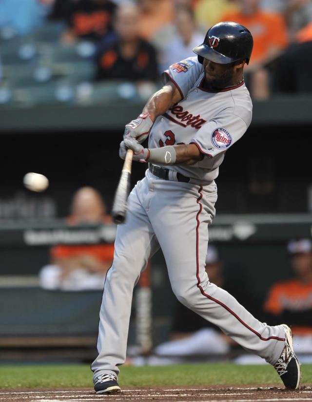 Minnesota Twins Danny Santana connects for a single against the Baltimore Orioles in the first inning of a baseball game, Saturday, Aug. 30, 2014, in Baltimore.(AP Photo/Gail Burton)
