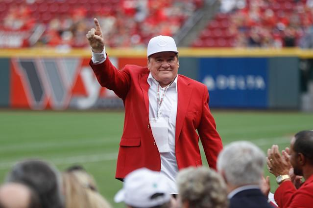 "Former <a class=""link rapid-noclick-resp"" href=""/mlb/teams/cincinnati/"" data-ylk=""slk:Cincinnati Reds"">Cincinnati Reds</a> player and guest Pete Ross acknowledges spectators during an Cincinnati Reds Hall of Fame induction ceremony before a baseball game against the Pittsburgh Pirates, Saturday, July 21, 2018, in Cincinnati. (AP Photo/John Minchillo)"