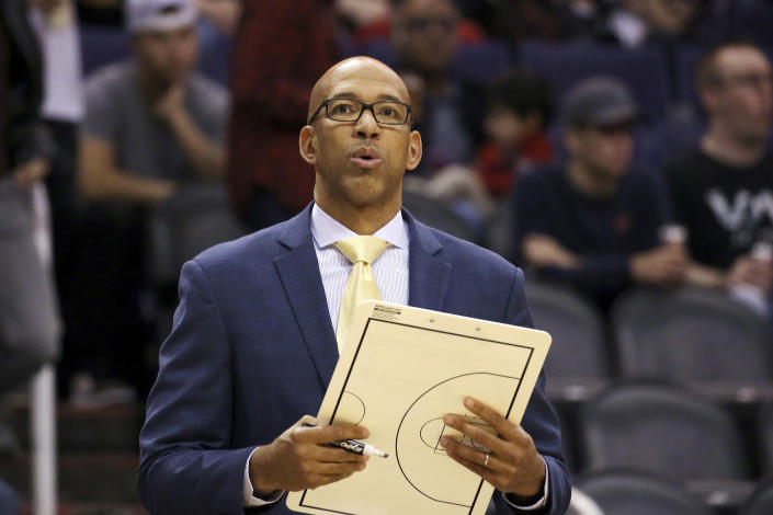 Phoenix Suns head coach Monty Williams pauses near the bench during the second half of an NBA basketball game against the Memphis Grizzlies, Wednesday, Dec. 11, 2019, in Phoenix. The Grizzlies defeated the Suns 115-108. (AP Photo/Ross D. Franklin)