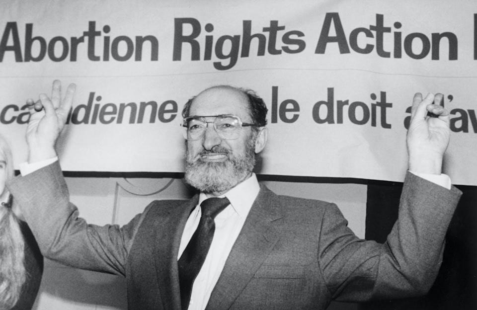 Dr. Henry Morgentaler raises his arms in victory.