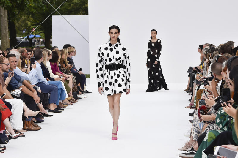 NEW YORK, NEW YORK - SEPTEMBER 09: Cyrielle Lalande and Ning Jinyi walk the runway at the Carolina Herrera show during New York Fashion Week at Garden of the Battery on September 09, 2019 in New York City. (Photo by Peter White/WireImage)