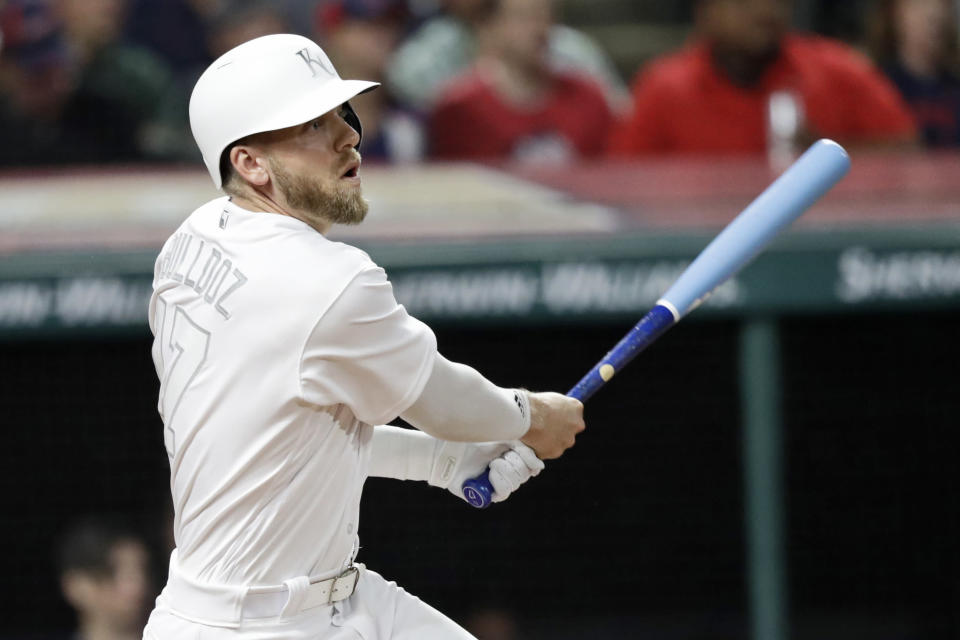 Kansas City Royals' Hunter Dozier watches his one-run triple in the sixth inning in a baseball game against the Cleveland Indians, Friday, Aug. 23, 2019, in Cleveland. (AP Photo/Tony Dejak)