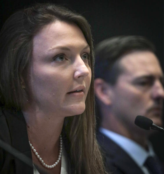 Courtney Wild, left, joined by her attorney Brad Edwards, reads a statement during a news conference, calling on victims of Jeffrey Epstein to contact the FBI or lawyers with their information, Tuesday, July 16, 2019, in New York. (AP Photo/Bebeto Matthews)