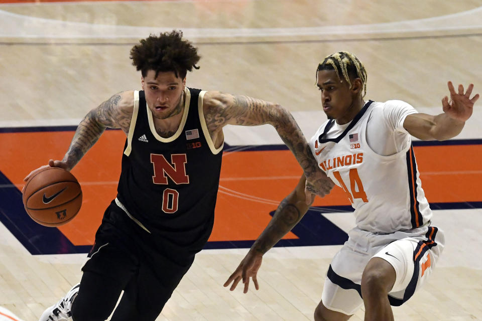Nebraska's guard Teddy Allen (0) drives past Illinois guard Adam Miller (44) during the first half of an NCAA college basketball game Thursday, Feb. 25, 2021, in Champaign, Ill. (AP Photo/Holly Hart)