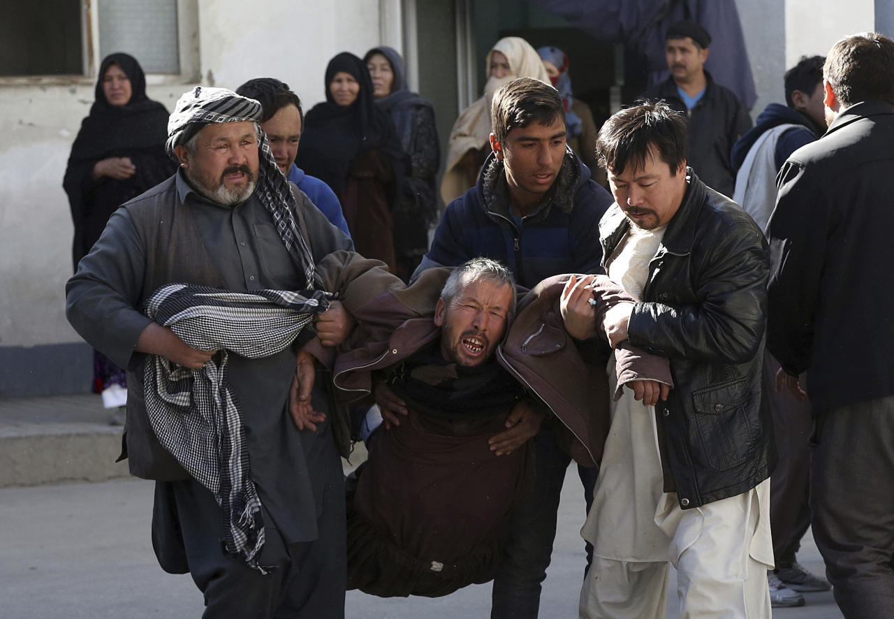 <p>A distraught man is carried following a suicide attack in Kabul, Afghanistan, Thursday, Dec. 28, 2017. (Photo: Rahmat Gul/AP) </p>