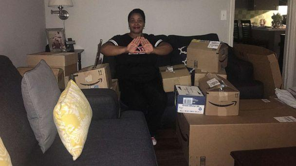 PHOTO: Michelle Lindsey poses with school supplies donated by members of Delta Sigma Theta Sorority. (Michelle Lindsey)