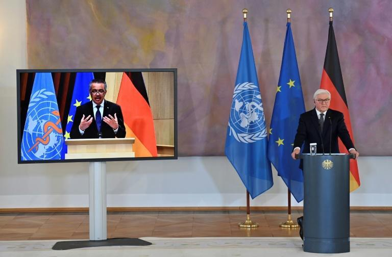 WHO chief Tedros Adhanom Ghebreyesus (left), with German President Frank-Walter Steinmeier, said the money was there to procure doses for some of the poorest countries, but it was worthless if there was nothing to buy