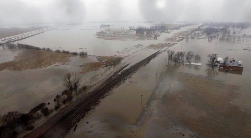 This March 19, 2019 aerial photo shows flooding along the Missouri River in Pacific Junction, Iowa. The U.S. Army Corps of Engineers says rivers breached at least a dozen levees in Nebraska, Iowa and Missouri.