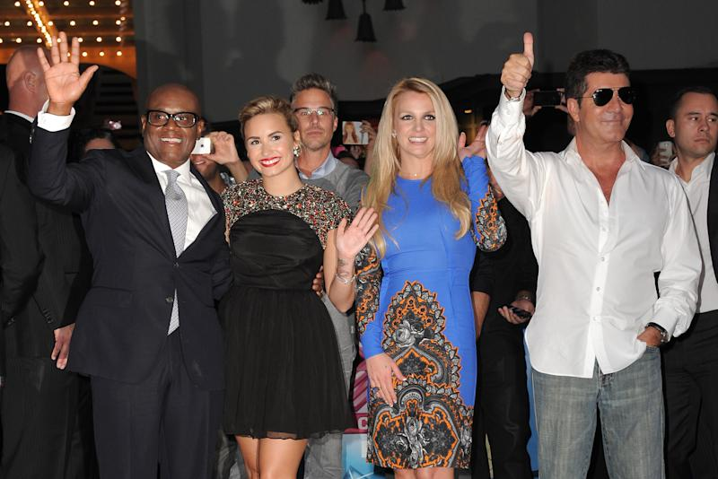 "Judges, from left, L.A. Reid, Demi Lovato, Britney Spears and Simon Cowell attend ""The X Factor"" season two premiere at Grauman's Chinese Theatre on Tuesday, Sept. 11, 2012, in Los Angeles. (Photo by Jordan Strauss/Invision/AP)"
