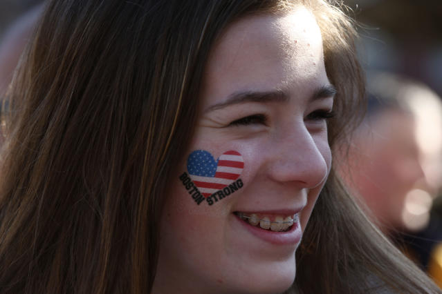 Sophie Ordman, of Calgary, Alberta, awaits the start of the 118th Boston Marathon Monday, April 21, 2014 in Boston. Her mother is competing in the race. (AP Photo/Matt Rourke)