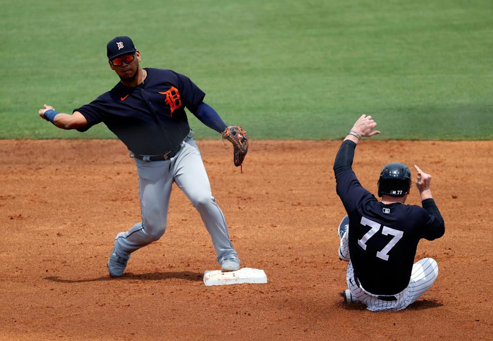 Detroit Tigers shortstop Isaac Paredes (19) forces out New York Yankees left fielder Clint Frazier (77) and throws throws the ball to first base for a double play during the second inning March 29, 2021, at George M. Steinbrenner Field in Tampa, Florida.