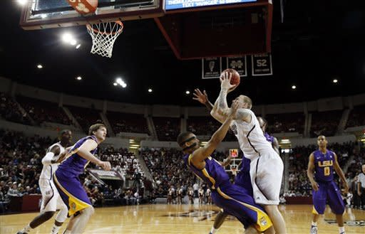 Mississippi State forward Colin Borchert (3) is fouled by LSU guard Corban Collins (4) as he shoots along the baseline in the first half of N NCAA college basketball game in Starkville, Miss., Saturday, Feb. 2, 2013. (AP Photo/Rogelio V. Solis)