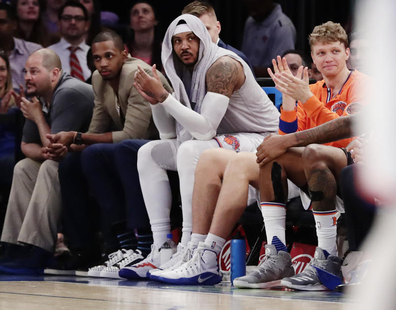 Carmelo Anthony has an $8.1 million trade bonus and a no-trade clause. (AP)