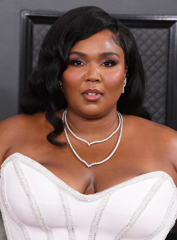 """<p>Lizzo took home an impressive three Grammys this year and barely bat an eye. There to help her just in case she did: makeup artist <a href=""""https://www.instagram.com/iwantalexx/?hl=en"""" target=""""_blank"""" class=""""ga-track"""" data-ga-category=""""Related"""" data-ga-label=""""https://www.instagram.com/iwantalexx/?hl=en"""" data-ga-action=""""In-Line Links"""">Alexx Mayo</a>, who applied $6 false lashes from KISS ahead of the big night. </p>"""