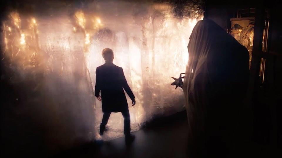 Twelfth Doctor in front of wall
